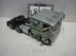 A Franklin Mint scale model of a 1979 Freightliner & trailer, papers, all boxed