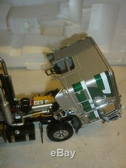 A Franklin mint model of a 1979 Freightliner Tractor unit. Boxed